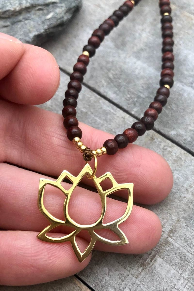 Gold Lotus Rosewood Necklace in hand