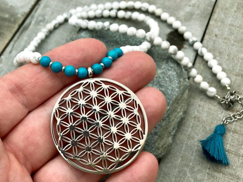 flower of life necklace in hand